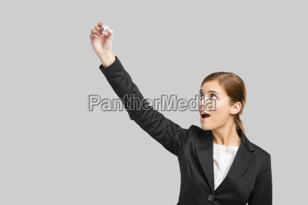 businesswoman drawing on a glass board