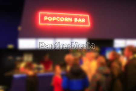 people stand in line for popcorn