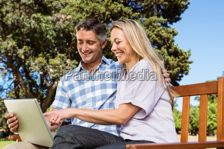 couple relaxing in the park with