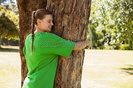 environmental activist hugging a tree in