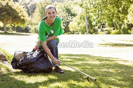 environmental activist picking up trash