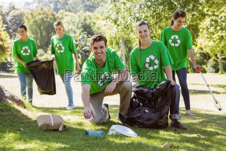 environmental activists picking up trash