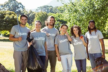 team of volunteers picking up trash