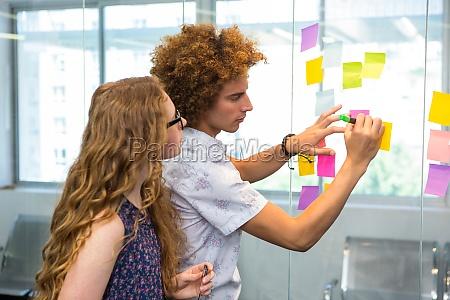 creative team looking at adhesive notes