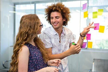creative team pointing at adhesive notes