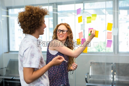 creative business team pointing at adhesive