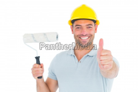 manual worker with paint roller gesturing