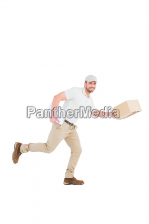 delivery man with cardboard boxes running