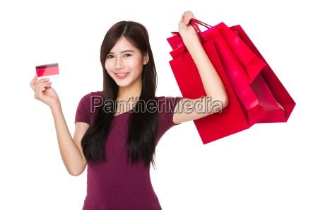 woman showing with shopping bag and