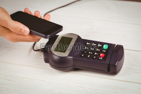 man using smartphone to express pay