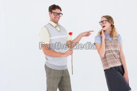 geeky hipster holding rose and pointing