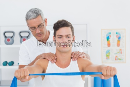 doctor examining his patient back