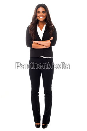 female employee posing with arms crossed