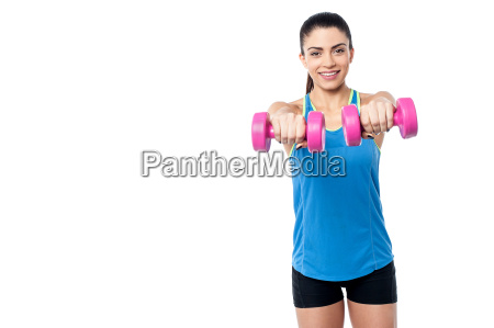 pretty woman lifting dumbbells