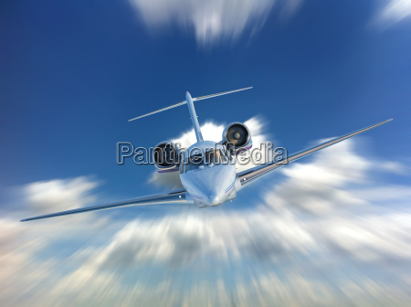 private jet airplane flying front view