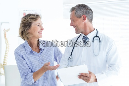 doctor showing his notes to his