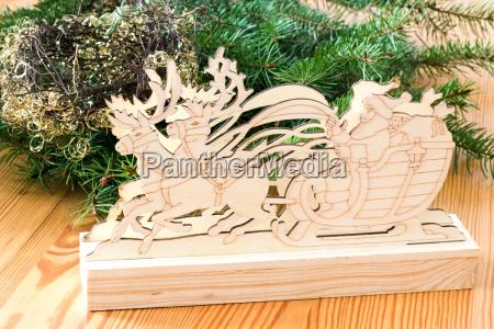 santa claus in reindeer sled