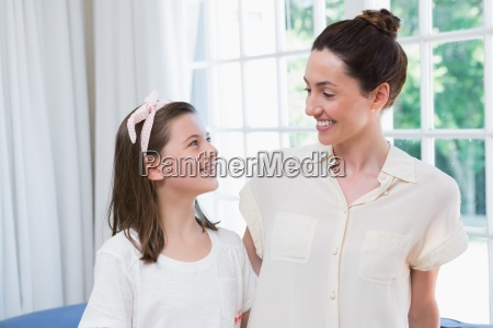 mother and daughter smiling at each