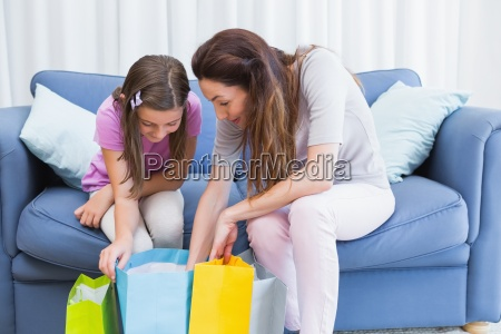 mother and daughter looking at shopping
