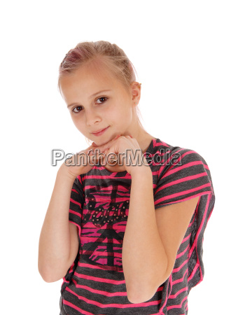 young girl with hands under chin