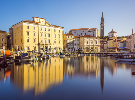 buildings of piran old town reflected