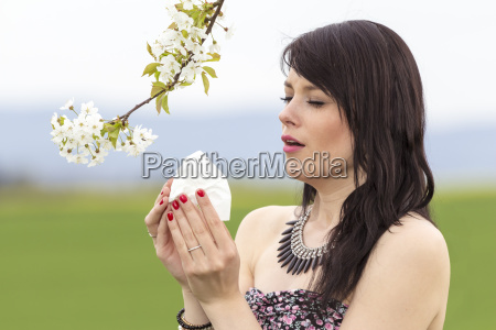 sneezing hayfever girl is pained in