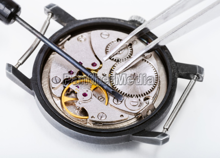 tools on open repaired watch close