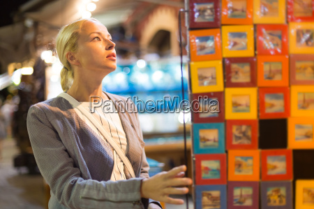 casual blond woman shopping for vacation