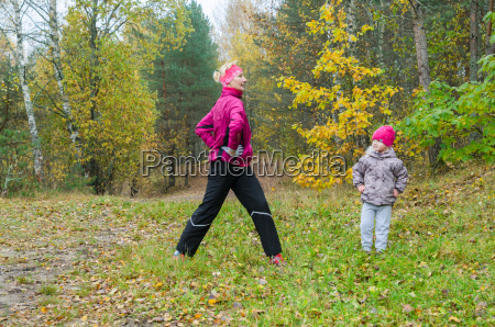 woman with girl doing aerobics in