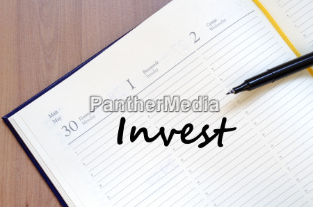 invest write on notebook
