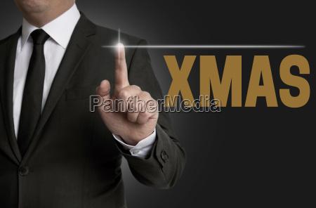 xmas touchscreen of businessman serving concept