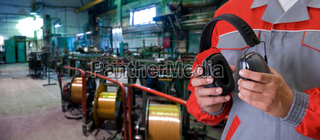 worker with protective headphone