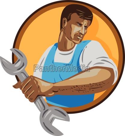 mechanic worker holding spanner circle wpa