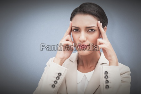 composite image of young businesswoman putting