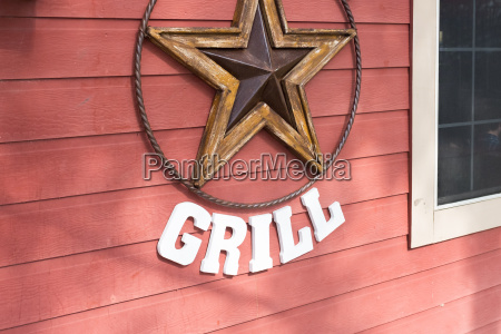 rusty metal star sign hanging on