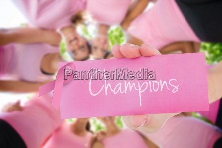 champions against smiling women organising event