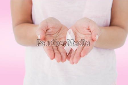 composite image of woman holding pink
