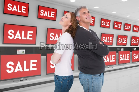 composite image of casual couple smiling