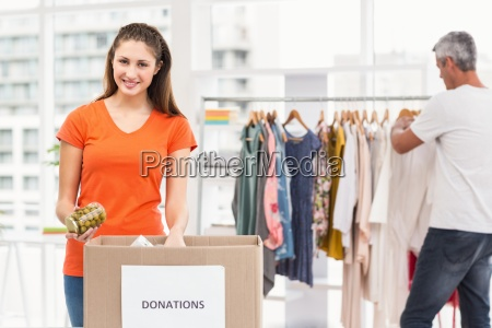 smiling casual businesswoman sorting donations