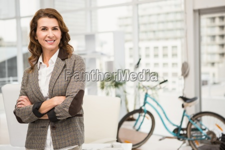 smiling casual businesswoman with arms crossed