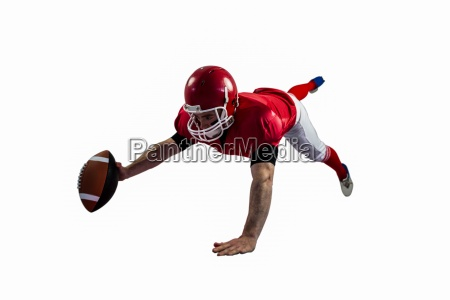 american football player reaching football