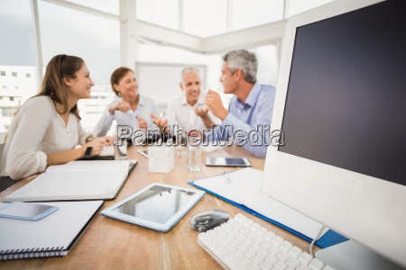 electronic devices in front of talking