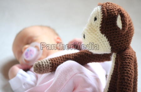 sleeping newborn is guarded by crocheted