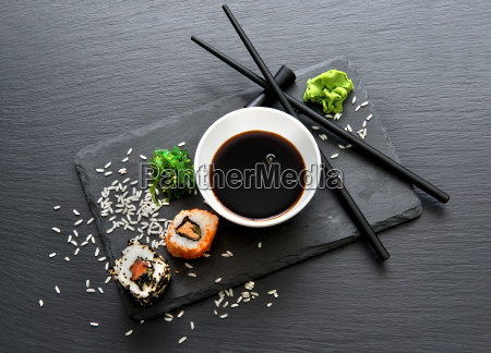 rolls with sauce and chopsticks