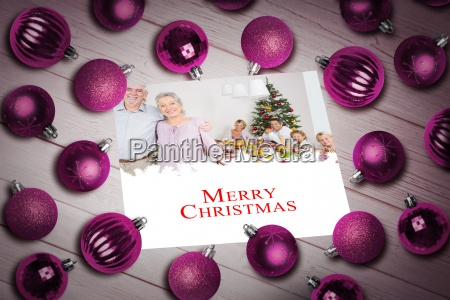 composite image of christmas baubles on
