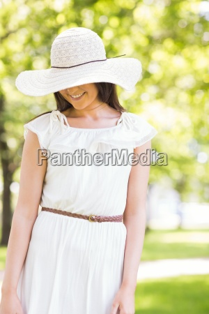 happy young woman in sun hat