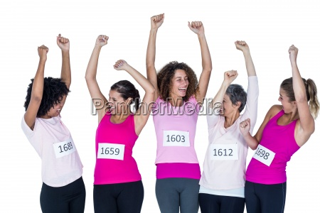 happy athletes with arms raised