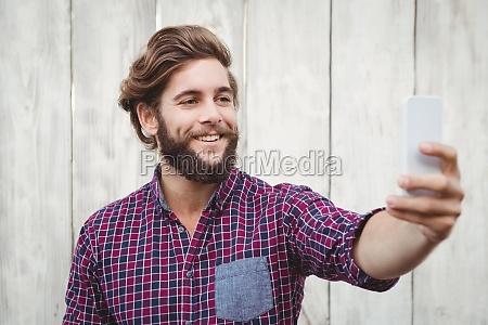 happy hipster taking selfie