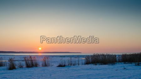 winter sunset on the sea the