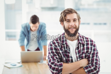 portrait of smiling businessman standing with